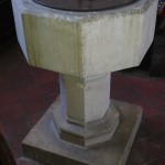 The font at All Saint's Church, Buncton, West Sussex